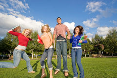 Students Jumping Stock Photography