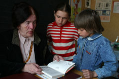 Students of junior classes are next to school teacher, Russia. Stock Images