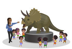 Students kids children in the paleontological museum education centr trip looking at dinosaur Triceratops. Teacher indian african Royalty Free Stock Photos