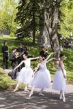 Ballerinas and musicians presenting a public performance in Notre-Dame-des-Neiges Cemetery stock photography