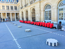 Students of l`Ecole Polytechnique pause in the Palais Royal Royalty Free Stock Photo