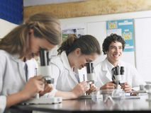 Students In Laboratory With Microscope Royalty Free Stock Photos