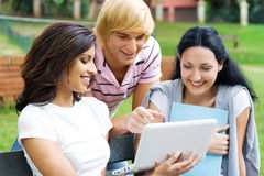 Students and laptop Royalty Free Stock Photography