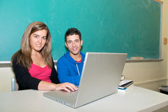Students with laptop in classroom royalty free stock image