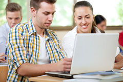 Students with laptop in classroom Royalty Free Stock Photos
