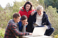 Students with laptop computer. Laughing Royalty Free Stock Photo