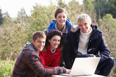 Students with laptop computer. Smiling at camera Royalty Free Stock Photo