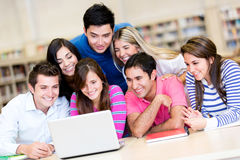 Students with a laptop computer Stock Image