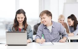 Students with laptop and notebooks at school Stock Photography