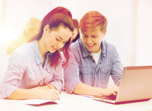 Students with laptop and notebooks at school Royalty Free Stock Photography