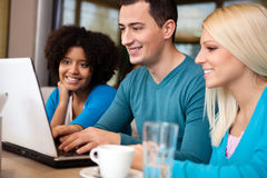 Students with laptop. Students  sitting in cafe and  using laptop Royalty Free Stock Images