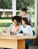 Students With Laptop Studying Together In Stock Images