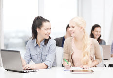 Students with laptop, tablet pc and notebooks Stock Image