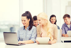 Students with laptop, tablet pc and notebooks Royalty Free Stock Photos