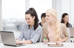 Students with laptop, tablet pc and notebooks Stock Photo