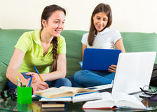 Students with laptops doing homework Stock Photography
