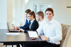 Students with laptops and tablet Royalty Free Stock Photography