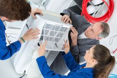 Students learn air conditioning repair from experienced instructor Royalty Free Stock Images