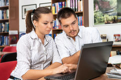 Students learn online in a library Stock Images