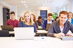 Students learning with computers stock image