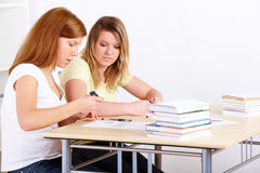 Students learning at desk Royalty Free Stock Photos