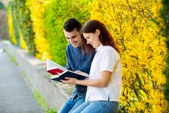Students learning for exam together in a city park. Students Brainstorming Meeting  learning for exam. Fast learning concept. Students Teamwork stock photography