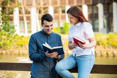 Students learning for exam together in a city park. Students Brainstorming Meeting learning for exam. Fast learning concept. Students Teamwork stock images
