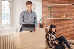 Students learning for examinations together with eBook in home interior. Couple students learning for examinations together with eBook in home interior stock image