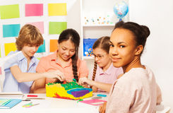 Students learning geography at the classroom Stock Image