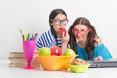 Students learning and having healthy snack Royalty Free Stock Photos
