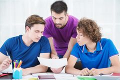 Students learning new information in classroom Stock Photo