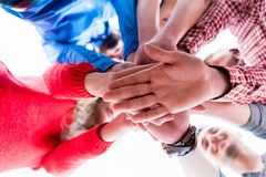 Students learning and stacking hands together Stock Images