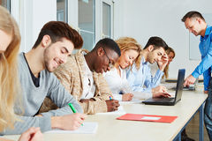Students learning with teacher Stock Photo