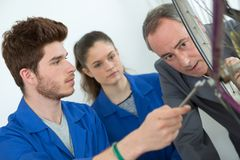 Students learning to repair bicycle stock photography