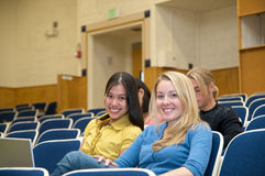 Students in lecture hall. Diverse ethnic Students on university campus. A photo of Asian, Hispanic and Caucasian students Royalty Free Stock Photography