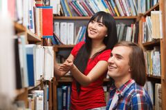 Students in a library Stock Photos