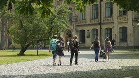 Students life, young men and women walking on university campus, education. Stock footage stock video footage
