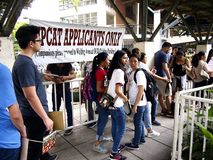 Students line up to submit their application form for the college entrance exam called UPCAT of the state university, University o. QUEZON CITY, PHILIPPINES royalty free stock photo