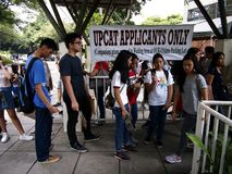 Students line up to submit their application form for the college entrance exam called UPCAT of the state university, University o. QUEZON CITY, PHILIPPINES stock photo