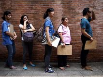 Students line up to submit their application form for the college entrance exam called UPCAT of the state university, University o. QUEZON CITY, PHILIPPINES royalty free stock photography