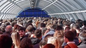 Students lined up in the pedestrian tunnel of the New Fair of Rome. Rome, Lazio, Italy - March 29, 2019: Students lined up in the pedestrian tunnel of the North stock footage