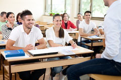 Students listening a lecturer Stock Photography