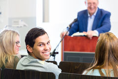 Students listening to college professor. Giving lecture Royalty Free Stock Image