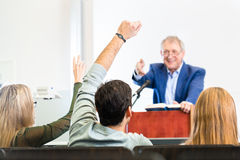 Students listening to college professor Royalty Free Stock Photo