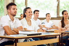 Students listening to a lecture. College students listening to a university lecture Royalty Free Stock Image