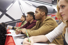Students listening to lecture at university lecture theatre Stock Photography