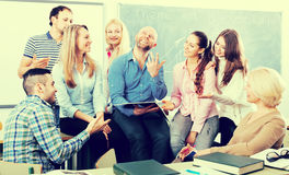 Students listening to teacher during break Royalty Free Stock Photo
