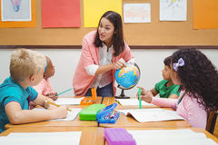 Students listening to the teacher Royalty Free Stock Photos