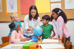 Students listening to the teacher Royalty Free Stock Images