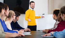 Students listening to teacher. Explaining material during lesson in class Royalty Free Stock Image